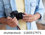 hands of photographer putting... | Shutterstock . vector #1183517971