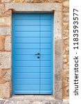 traditional blue front doors... | Shutterstock . vector #1183593577