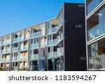 facade of new modern apartment... | Shutterstock . vector #1183594267