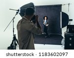 model posing for a photograph... | Shutterstock . vector #1183602097