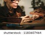senior female jewelry maker... | Shutterstock . vector #1183607464
