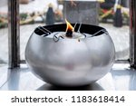 fire in the bowl burning on oil ... | Shutterstock . vector #1183618414