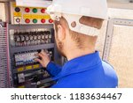 the electrician adjusts the... | Shutterstock . vector #1183634467