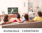 family watching television at... | Shutterstock . vector #1183653634