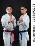 two guys karate on a dark... | Shutterstock . vector #1183692271