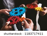 business team connect pieces of ... | Shutterstock . vector #1183717411