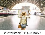 young woman traveler with... | Shutterstock . vector #1183745077
