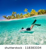 Man Swimming Underwater In A...