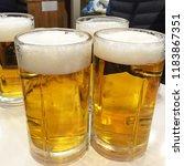 glasses of lager beer | Shutterstock . vector #1183867351