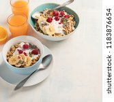 bowl of granola with yogurt and ...   Shutterstock . vector #1183876654