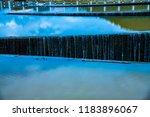 overflow of tha chomphu dam in...   Shutterstock . vector #1183896067