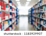 blurred image of bookshelf in... | Shutterstock . vector #1183929907