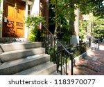 street and row of brownstones... | Shutterstock . vector #1183970077
