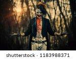 crazy evil clown man is... | Shutterstock . vector #1183988371