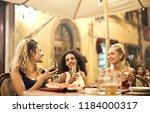 female friends having a drink... | Shutterstock . vector #1184000317
