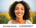 portrait of a young curly... | Shutterstock . vector #1184009857