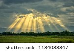 sunbeam in cloudy sky over rice ... | Shutterstock . vector #1184088847