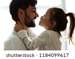 parenthood. family. love. dad...   Shutterstock . vector #1184099617
