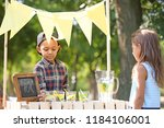 little african american boy... | Shutterstock . vector #1184106001