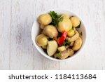 tasty salty pickled mushrooms... | Shutterstock . vector #1184113684