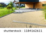 laying gray concrete paving... | Shutterstock . vector #1184162611