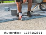 laying gray concrete paving... | Shutterstock . vector #1184162911
