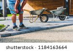 laying gray concrete paving... | Shutterstock . vector #1184163664