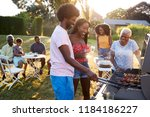couple grilling at a black... | Shutterstock . vector #1184186227