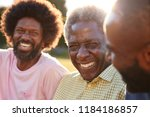 senior black man laughing with... | Shutterstock . vector #1184186857