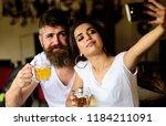 couple in love on date drinks... | Shutterstock . vector #1184211091