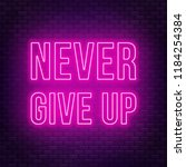 never give up neon lettering on ... | Shutterstock .eps vector #1184254384