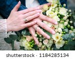 wedding rings on the fingers of ... | Shutterstock . vector #1184285134