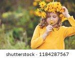 cute little girl with wreath of ... | Shutterstock . vector #1184287567