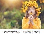cute little girl with wreath of ... | Shutterstock . vector #1184287591