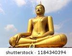 big golden buddha statue... | Shutterstock . vector #1184340394