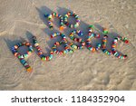colorful bottle caps spell out '... | Shutterstock . vector #1184352904