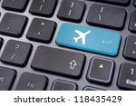 a plane sign on keyboard, to illustrate online booking or purchase of plane ticket or business travel concepts. - stock photo