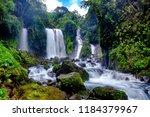 beautiful waterfall in daylight ... | Shutterstock . vector #1184379967