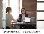 smiling businesswomen... | Shutterstock . vector #1184389294