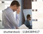 nervous sweaty business man... | Shutterstock . vector #1184389417