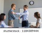 happy ceo handshaking... | Shutterstock . vector #1184389444