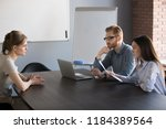 serious hr attentively... | Shutterstock . vector #1184389564