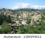a village on the hill | Shutterstock . vector #1184393011