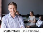 middle aged smiling company ceo ... | Shutterstock . vector #1184403061