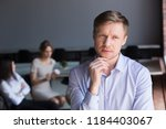 thoughtful doubtful middle aged ... | Shutterstock . vector #1184403067
