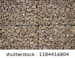 stone wall of a gabion as a... | Shutterstock . vector #1184416804