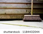 old used garden sweeping brush... | Shutterstock . vector #1184432044