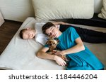 two brothers fell asleep on the ... | Shutterstock . vector #1184446204