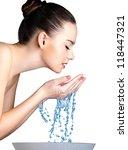 Beauty Woman Washing Her Face...