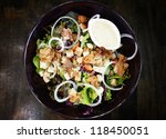 Salad With Cream Sauce In Blac...